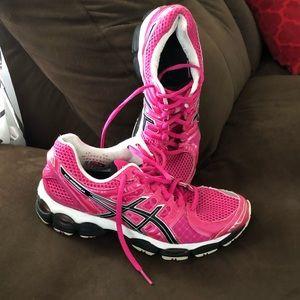 Vibrant pink ASICS Gel running shoes